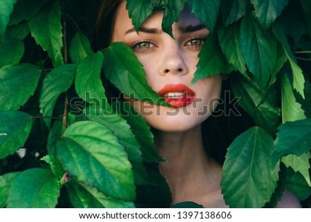 Red lips beautiful makeup green leaves park nature fresh air woman                            #1397138606