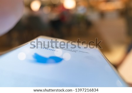 Taipei, Taiwan - May 12th, 2019:using social media at a smartphone in a restaurant in Taipei, Taiwan, Asia #1397216834
