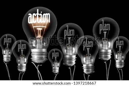 Group of shining and dimmed light bulbs with fibers in a shape of Action and Plan words isolated on black background; concept of Motivation and Success #1397218667