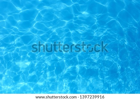 Blue color water in swimming pool rippled water detail background. #1397239916