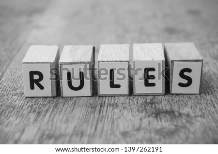 Closeup of word on wooden cube on wooden desk background concept - Rules #1397262191