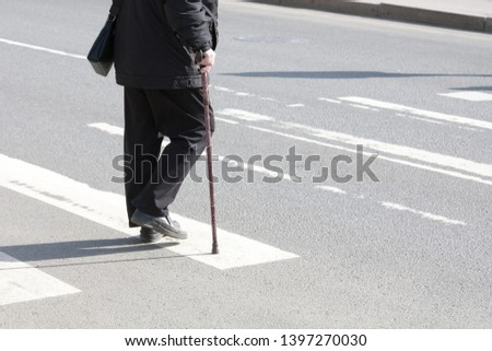 the disabled person walks in park on crutches #1397270030