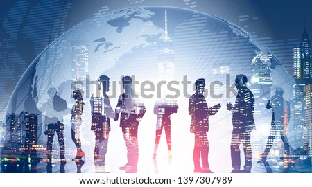 Business team members standing over night city background with double exposure of planet. Concept of international company and globalization. Toned image. Elements of this image furnished by NASA #1397307989