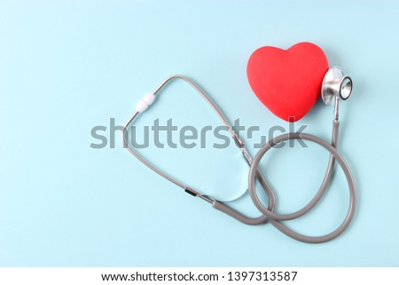 Stethoscope and heart on wooden color background. Health, medicine  #1397313587