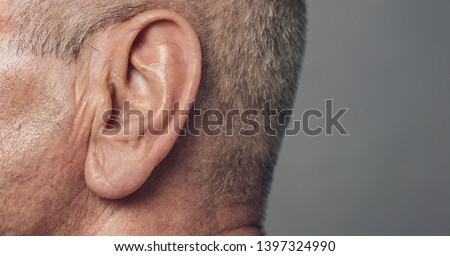 old senior man ear close-up macro shot Royalty-Free Stock Photo #1397324990