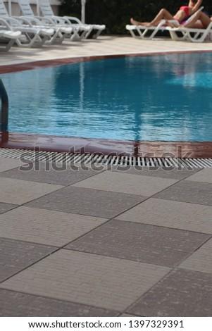 swimming pool in tropical resort #1397329391