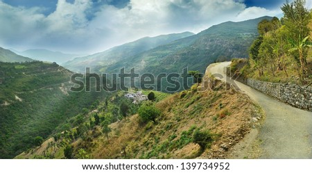 alpine landscape in the Himalayas and on the side of a dirt road #139734952