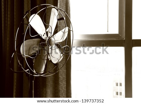 Old electric fan in sepia #139737352