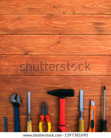 set of working tools on a wooden mahogany table #1397381690