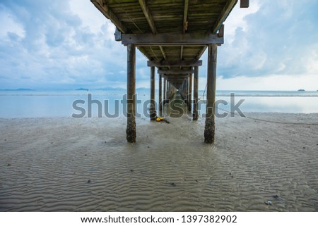 under and side view wooden bridge walkway at beach early morning, Thailand #1397382902
