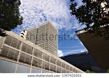 Restructuring of an office building. Complex of buildings under renovation with the construction of new facades. Blue sky with clouds. #1397431055