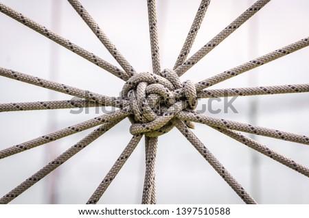many ropes and one big knot closeup Royalty-Free Stock Photo #1397510588
