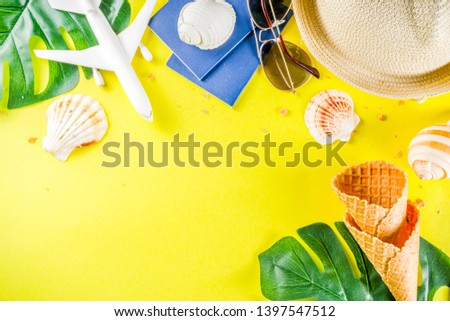 Travel and vacation flatlay concept. Summer bright colorful background with hat, sunglasses, plane,  passport, tropical leaves, travel cosmetics kit, seashells, copy space top view banner #1397547512