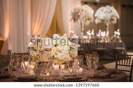 Romantic Wedding Table Top Layout Decor with large lush floral bouquets including white roses, ranunculus, persian buttercups, white orchids and candles #1397597660