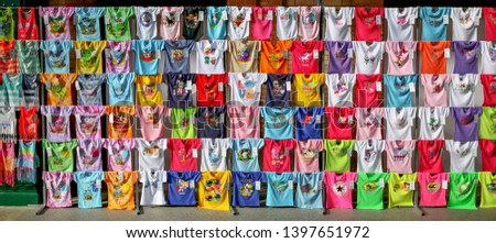 Sevilla, Spain - February 13, 2019: Collection of Summer colorful t-shirts with funny screen printings sold at souvenir shop in Seville, Spain. #1397651972