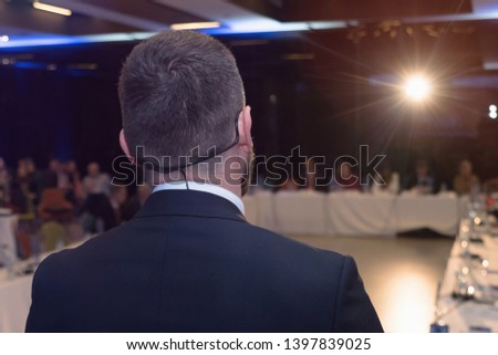 Young businessman at business conference room with public giving presentations. Audience at the conference hall. Entrepreneurship club. #1397839025