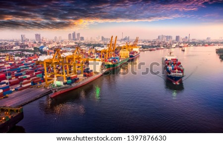 Logistics and transportation of Container Cargo ship and Cargo plane with working crane bridge in shipyard at sunrise, logistic import export and transport industry background #1397876630
