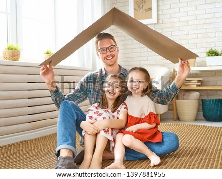 Father and children girls in the room with a symbol of roof. Concept of protection for kids.  #1397881955