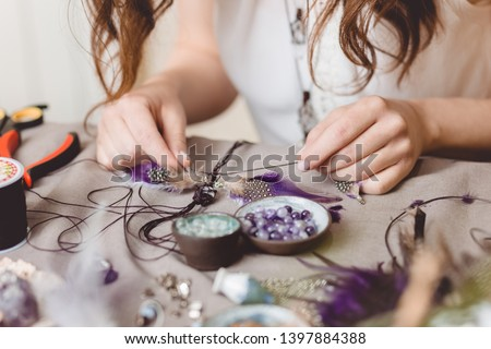 Woman making handmade gemstone jewellery, home workshop. Artisan woman creates jewellery. Art, hobby, handcraft concept #1397884388
