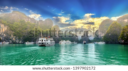 Beautiful Tourist cruise ship floating among limestone rocks at Ha Long Bay. This is the UNESCO World Heritage Site, it is a beautiful natural wonder in northern Vietnam #1397902172