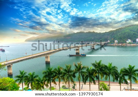 Van Don bridge connects Cam Pha City to Van Don peninsula in Quang Ninh, Vietnam Royalty-Free Stock Photo #1397930174