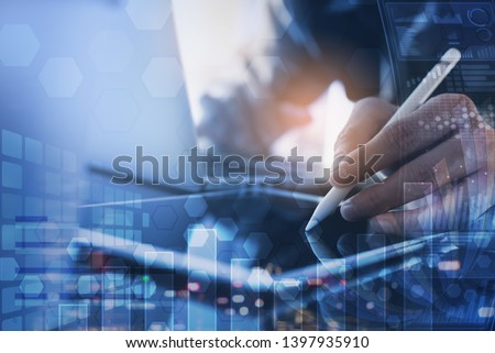 Business analysis, modern technology concept. Finance analyst working at office. Multitasking business man use digital tablet, working on laptop, financial graph, computer dashboard on virtual screen #1397935910