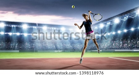 Young woman playing tennis in action. Mixed media #1398118976