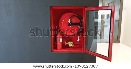 Fire hose reel and fire hose cabinet #1398129389