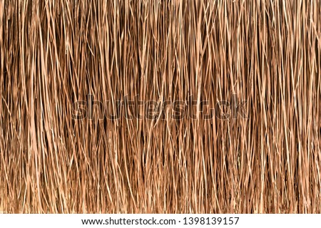 Thatched roof or wall background. Tropical roofing on beach Royalty-Free Stock Photo #1398139157