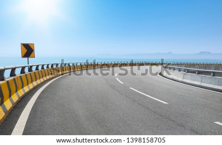 Dramatic curve elevated highway against beautiful blue sky. #1398158705