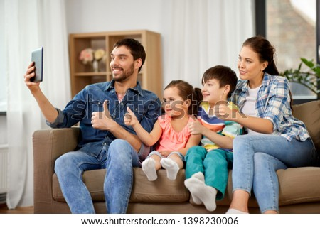 family and people concept - happy father, mother, little son and daughter having video call on tablet pc computer and showing thumbs up at home #1398230006