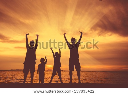 silhouette of happy family at the beach. #139835422