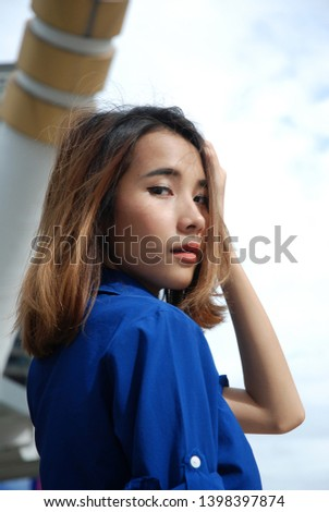 Beautiful Asia women smile portrait and traveling in the capital city. #1398397874