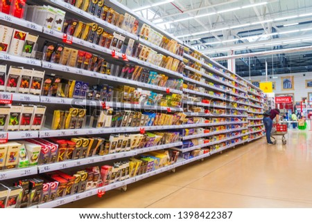 Russia, Samara, May 2019: Interior of the supermarket trading hall. Text in Russian: exit #1398422387