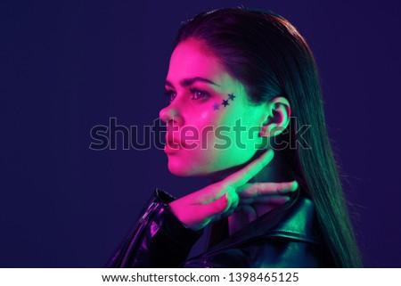 beautiful woman with make-up on face night club disco neon party #1398465125