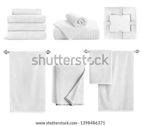 White bath textile items set isolated. Cotton terry towels- hanging, folded, stacked and packed against white background.  #1398486371