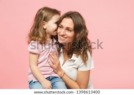 Woman in light clothes have fun with cute child baby girl. Mother, little kid daughter isolated on pastel pink wall background, studio portrait. Mother's Day love family, parenthood childhood concept #1398613400