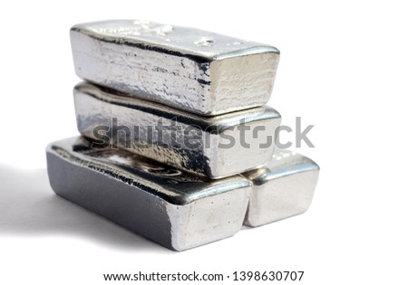 Pile silver bullion isolated on white background. Selective focus.  #1398630707