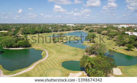 Golf course with gorgeous green and pond. Aerial view of a beautiful green golf course #1398674342