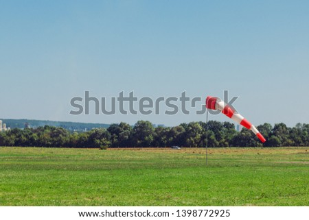 Windsock as a gauge for winds, wind vane on the aerodrome airfield on an air show #1398772925