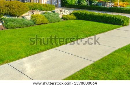 Pedestrian sidewalk, path at the empty street. Neighborhood scenery. #1398808064