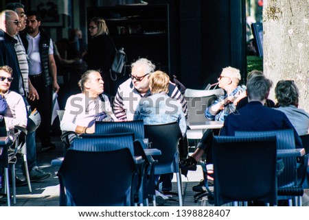 Reims France May 15, 2019 View of unknown people drinking at a restaurant terrace in the center of Reims during a sunny day #1398828407