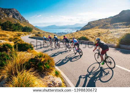 Team sport cyclist photo. Group of triathlete on bicycle ride on the road at Mallorca, Majorca, Spain. #1398830672