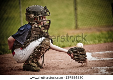 Baseball Catcher with Ball in Action Royalty-Free Stock Photo #139886530