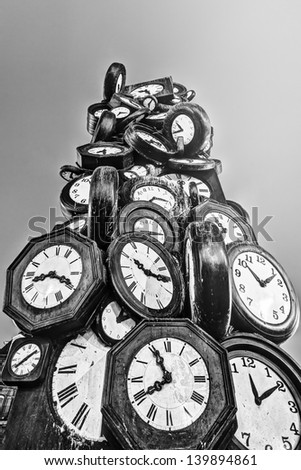black and white picture of a tower of clocks situated at the station St. Lazare in Paris