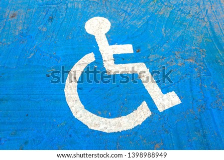Symbol of disabled car park On the blue road #1398988949
