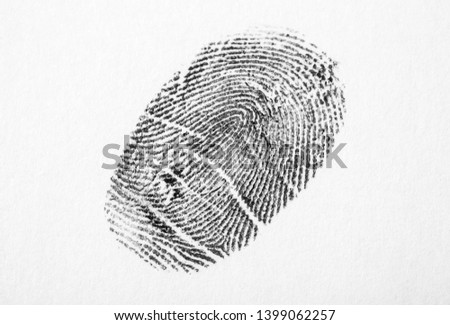 Black fingerprint on white background. Friction ridge pattern #1399062257