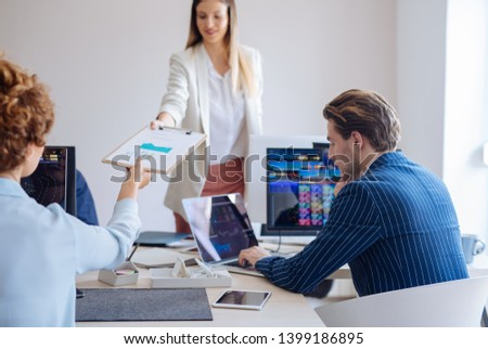 Group of business people working together with financial charts. #1399186895