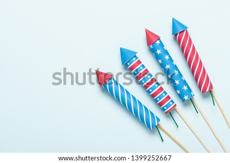 4th of July fireworks USA flag style rockets. Firecracker rockets United States Independence Day banner. #1399252667