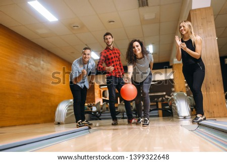 Male bowler throws ball, throwing in action #1399322648